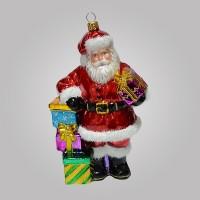 Christbaumfigur, Santa stützt sich auf Geschenkestapel, 11 x 18 cm